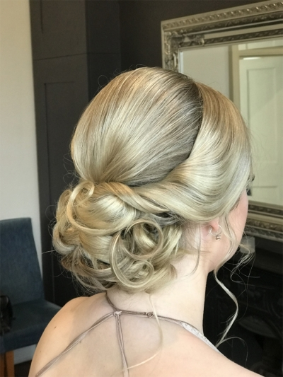 Soft, curled & twisted bun